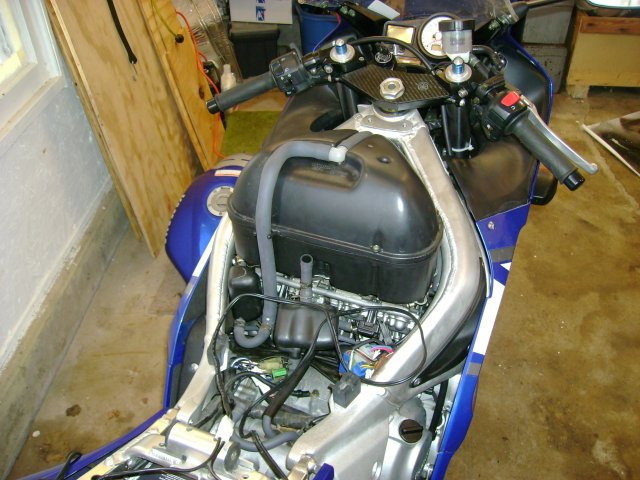 how motorcycles work com the loose wire is a battery maintainer and yes the crankcase breather is not connected yet it blocks access to the synchronization tubes